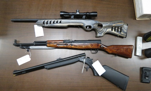 Recovered rifles during parole compliance check