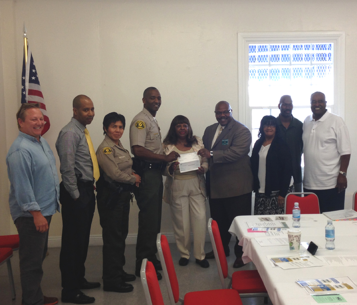 $1000 donation presented by the Compton Business Chamber of Commerce