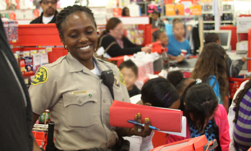 Deputy Quiana Birkbeck at TARGET with students from Tibby Elementary School