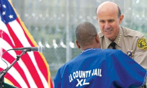 Sheriff Baca with a MERIT graduate
