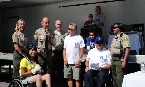 "Sheriff Lee Baca and Group announcing Winner of ""Sheriff's Car Award"""