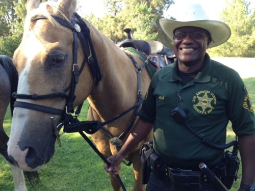Dep. Lloyd standing next to his horse Colonel