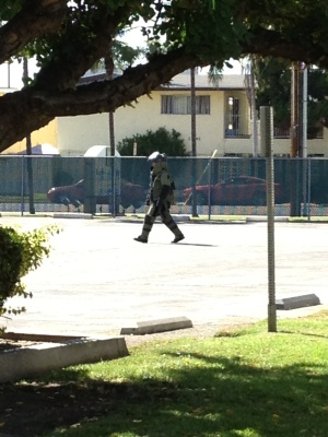 Arso/Explosive Detail Member in Full Body Suit going into building