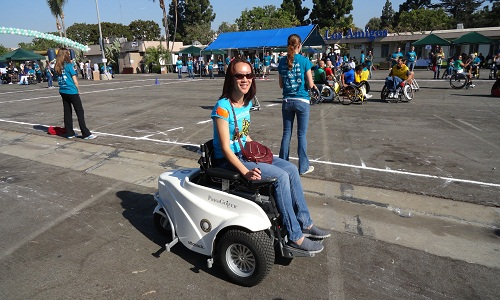 Female participant on electric wheelchair