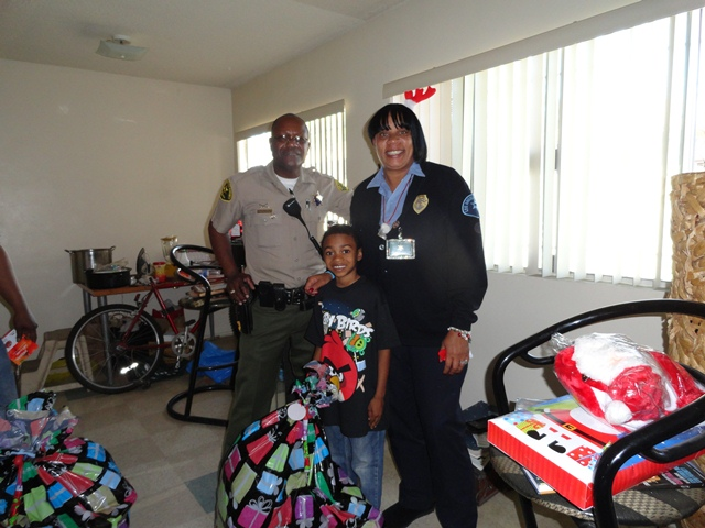 Picture of Deputy Lloyd and Law Enforcement Technician Johnson with Bags of Toys