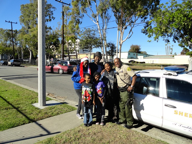 Picture of Deputy Lloyd and Family by Patrol Car