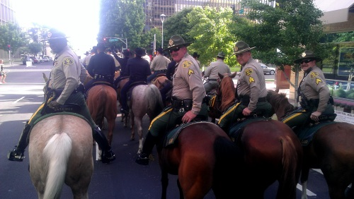 Picture of Los Angeles County Sheriff's Department Mounted Enforcement Unit at event looking back while riding their horses.