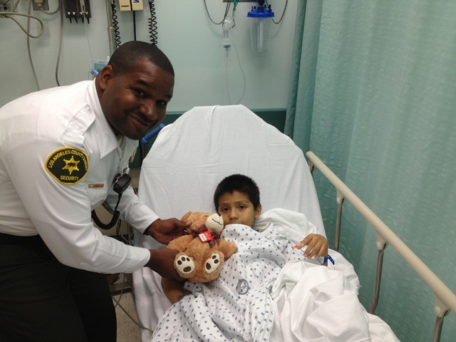 Picture of Sheriff's Secuirty Officer and Patient