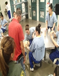 Pet Pescription Volunteer Jack with therapy dog Logan visiting female Inmates