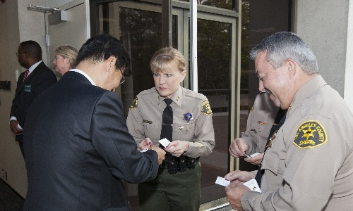 LASD Chief Roberta Abner exchanges business cards