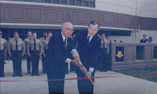 NCCF was christened on March 1st, 1990, by Sheriff Block and President George H.W. Bush as the Flagship of Custody